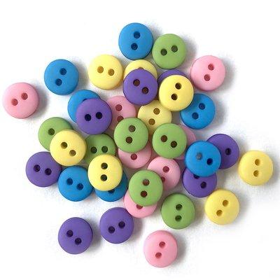 mini knoopjes zachte kleuren